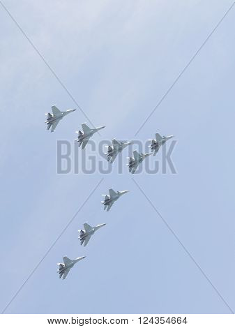 Moscow-May 9 2015: Eight powerful multipurpose heavy fighter gray-blue Su-30 flying high in the blue sky in the Victory Parade in Moscow on May 9 2015 Moscow Russia