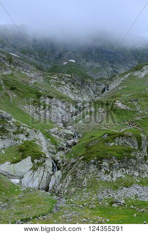 Waterfalls in the foggy Rila mountains in Bulgaria in the summer