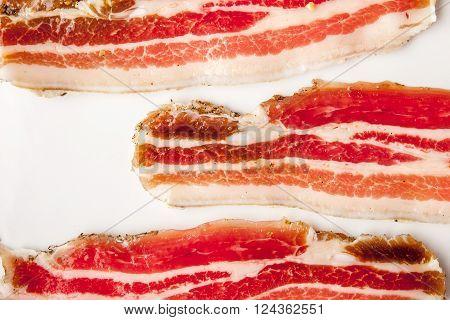 Streaky bacon on the white background horizontal
