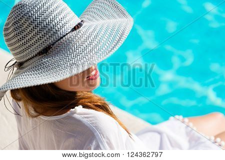 Pretty Woman Relaxing At Poolside On Summer Vacation