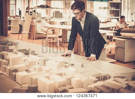 Young architect working in architect studio.