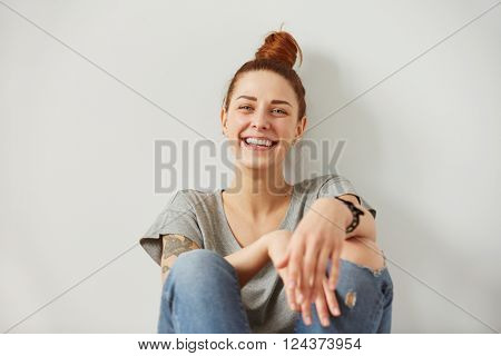 Woman laughing. Closeup portrait woman smiling with perfect smile and white teeth looking laugh loudly in full disbelief isolated background. Positive human emotion facial expression body language.