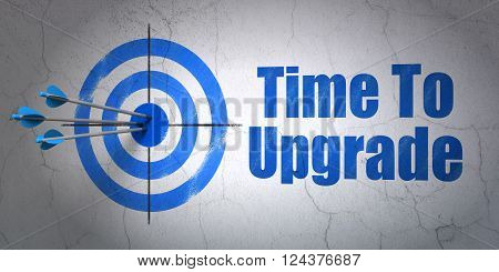 Time concept: target and Time To Upgrade on wall background