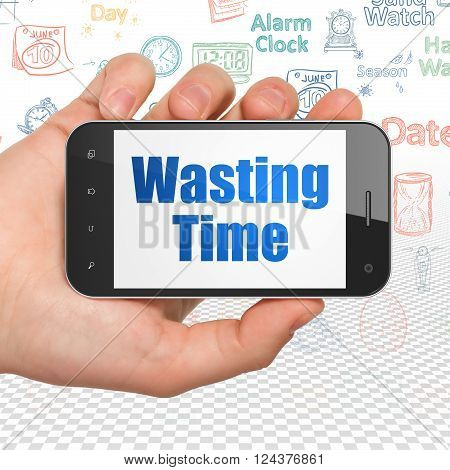 Time concept: Hand Holding Smartphone with Wasting Time on display