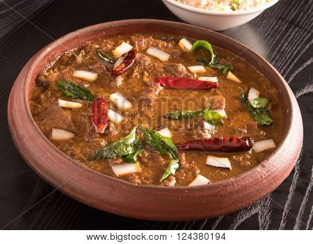 delicious mutton curry in a clay bowl
