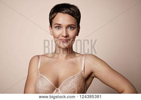 Happy Smiling Woman Wears Bra. Beige Background