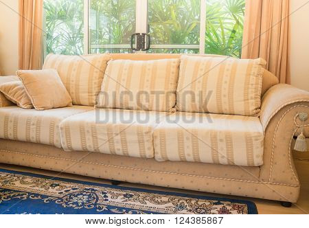 Beautiful orange sofa in living room stock photo