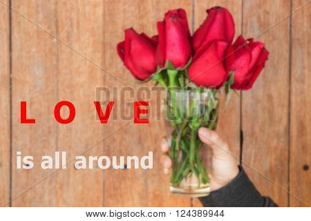 Love is all around quote design poster stock photo