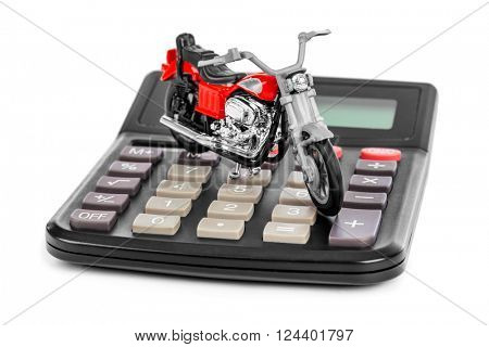 Calculator and toy motorbike isolated on white background