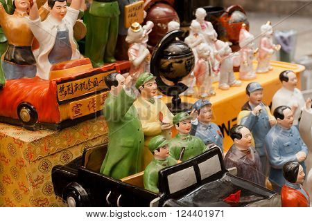 HONG KONG, CHINA - FEB 12: Vintage porcelain figurines of Chinese Communist leaders at antique market traders on February 12, 2016. More than 47 million tourists visit Hong Kong annually