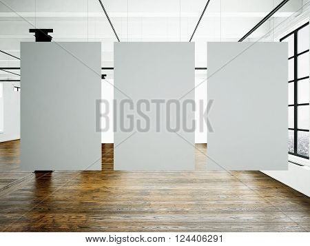 Photo of museum interior in modern building.Open space studio. Empty white canvas hanging.Wood floor, bricks wall, panoramic windows. Blank frames ready for bussiness information.Horizontal. 3D rendering