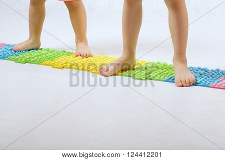 Childrens Feet On A Orthopaedic Mat