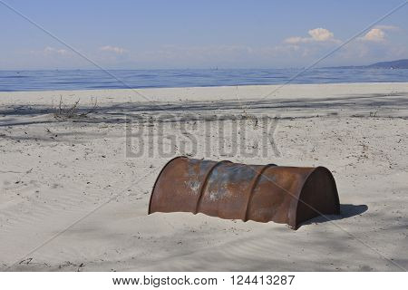 Old Rusty Oil Barrel Buried in Sand End of Oil Age