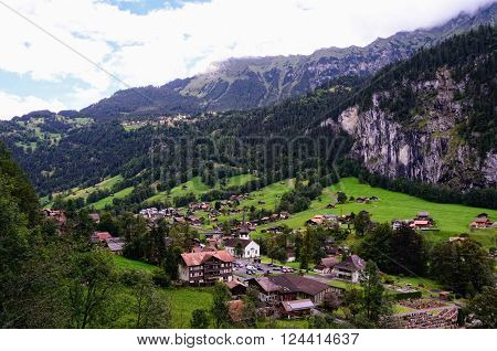 Tourist Town of Lauterbrunnen in Lauterbrunnen Valley (Switzerland, Canton of Bern, Jungfrau Region) seen from Staubbach Falls