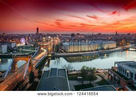 WROCLAW POLAND - APRIL 01 2016: Aerial view of Wroclaw. Illuminated city skyline during a beautiful sunset April 01 2016 in Wroclaw Poland.