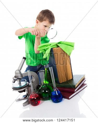 Scientist small boy with magnifying glass. Isolated on white background