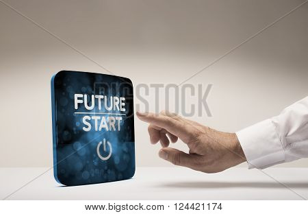 Finger about to press modern screen with the text future start beige background. Concept image for illustration of innovation or strategic vision.