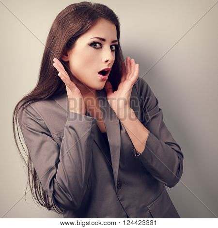 Stressed Surprising Business Woman In Suit With Hand Near Face Looking