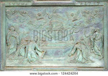 PISA, ITALY - JUNE 06: The Assumption of the Virgin Mary, panel from Giambologna's school, collocated in the central portal of the Cathedral St. Mary of the Assumption in Pisa, Italy on June 06, 2015