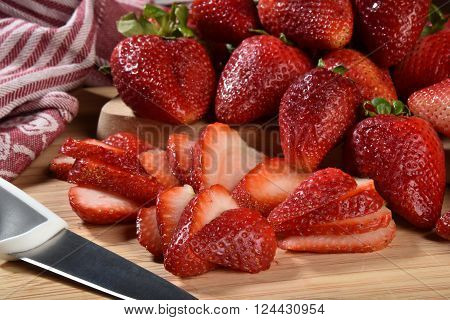 Fresh ripe organic strawberries on a cutting board