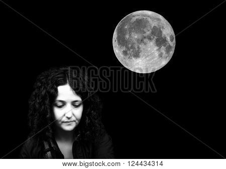 Goth girl in the dark night with full moon - with copy space