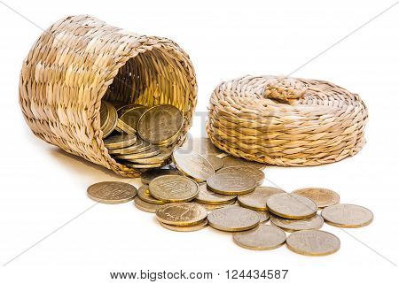 Wicker basket with gold coins as savings