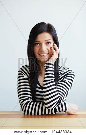 Portrait Of Smiling Beautiful Woman Leaning On Her Hand