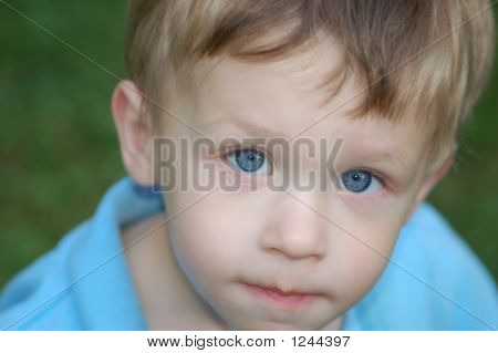 Little Boy With Blue Eyes