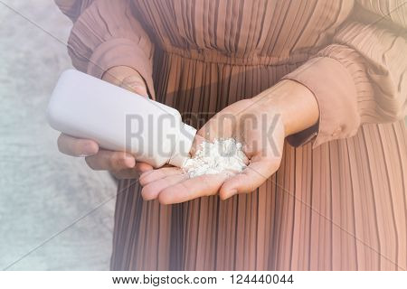 Close up women hands apply talcum powder