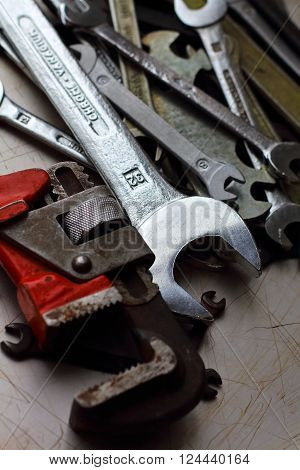 set of different wrenches on a metal background