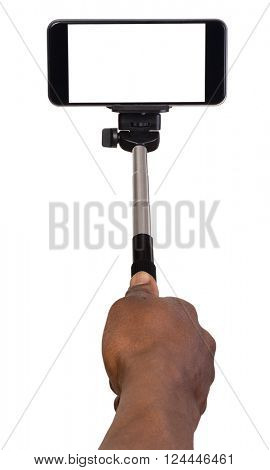 Man taking selfie using hand hold monopod and a mobile phone