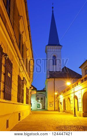 KOSICE, SLOVAKIA - MARCH 20, 2016: Church and historic architecture in the centre of Kosice city in eastern Slovakia on March 20, 2016.