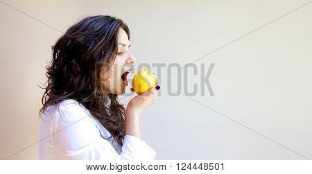 A Young A Lady Bites A Lemon