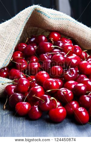 a group of fresh red cherry on wood