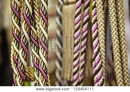 Close-up of multicolored ropes, they hang close next to each other in a row