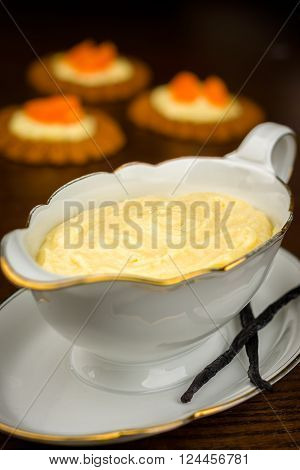 Homemade cream pastry in saucier with Vanilla pod
