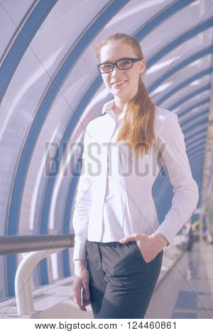 business woman in glasses  It is located in an office window