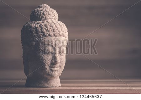 Image of a Buddha head with vintage look