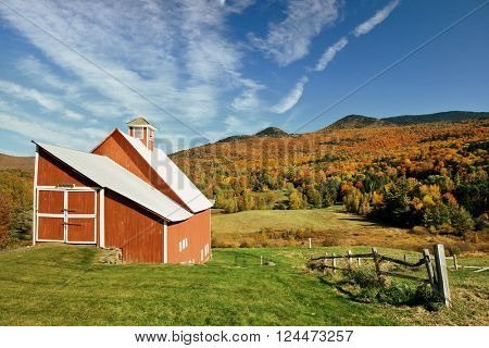 A farm house and Autumn foliage in New England