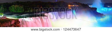Niagara Falls lit at night panorama by colorful lights