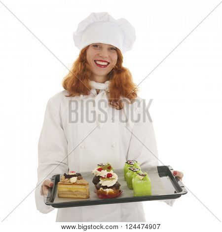 Female baker chef with red hair proud with baked Christmas pastries isolated over white background