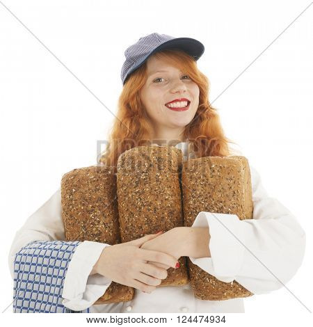 Female baker chef with red hair and baked bread  isolated over white background