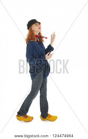 Funny female farmer from Holland looking up isolated over white background