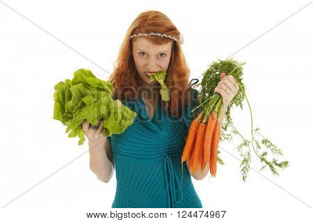 Young woman eating lettuce and carrots for diet isolated over white background