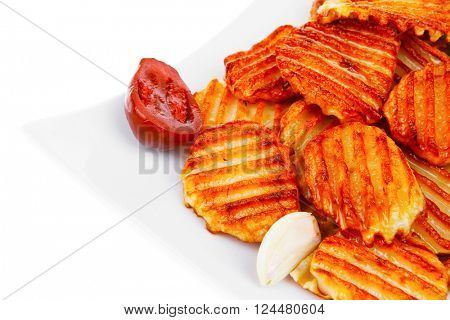 potato chips served on white plate with small pickled eggplants isolated over white background