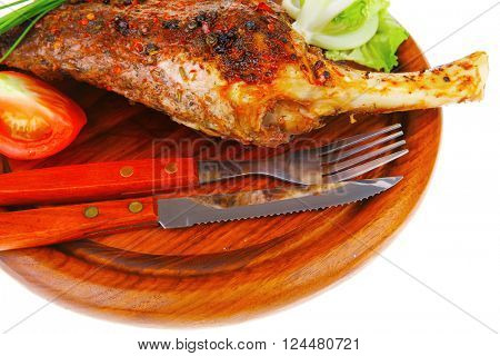 savory plate on wood : grilled shoulder on plate with chives and tomato isolated on white background