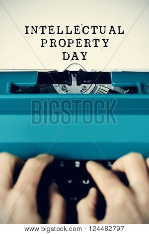 the text intellectual property day written in a paper with a retro typewriter