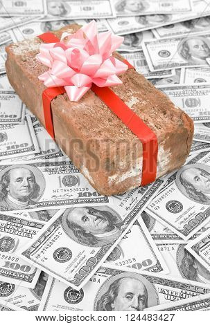 Red Brick Gift and dollars Concept of joke make fun of somebody gift on April Fool's Day Prank gift