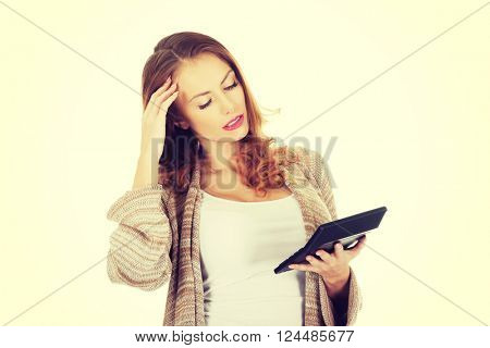 Beautiful woman with calculator.