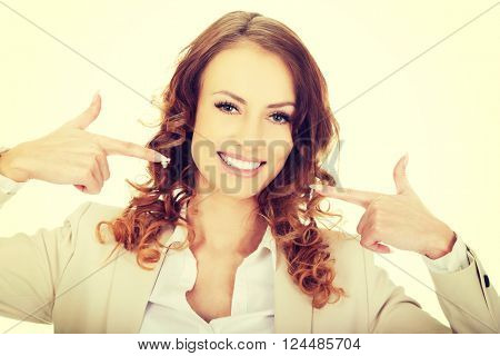 Business woman shows us her teeth.